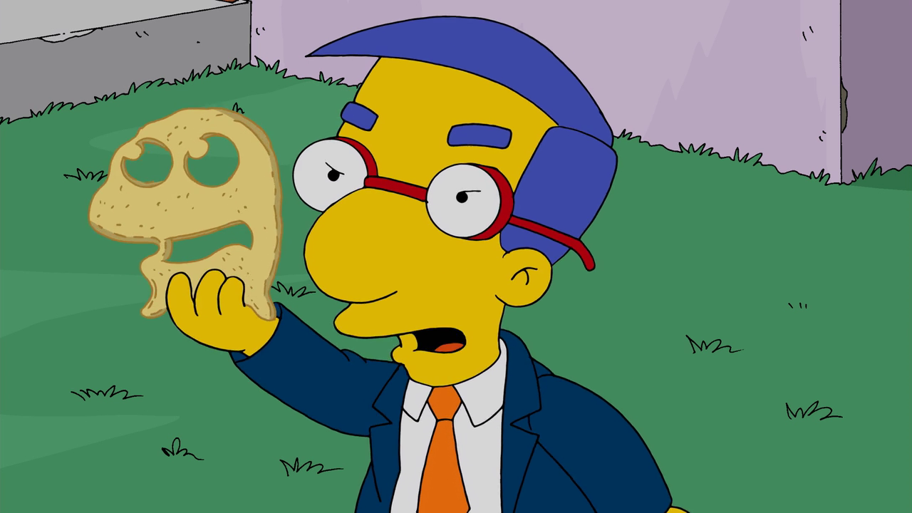 Milhouse holding Muppet-shaped cheese.png