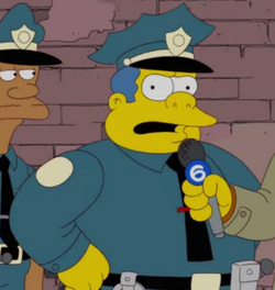 Chief Wiggum on the news.png