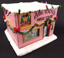 Simpsons Christmas Village King Toots.jpg