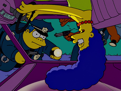 Marge upside down in the car.png